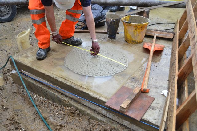 Technician testing structural screed compliance prior to pumping