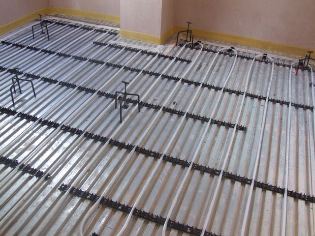 Lewis sheet over lattice joists prior to installation of flowing underfloor heating screed