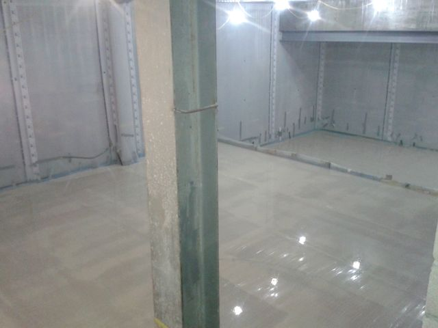 Completed flowing floor screed by Thermotech Screed London and newton membrane on the vertical surfaces.