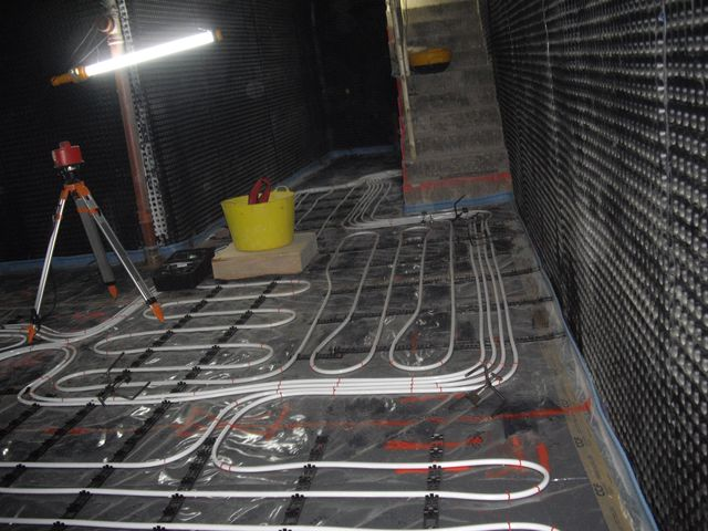 Underfloor heating pipework and floor grade insulation prior to Thermotech London underfloor heating screed being pumped